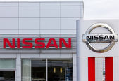 Nissan Motors automobile dealership and sign.