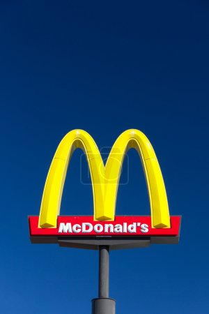 McDonald' sign. The McDonald's Corporation is the ...