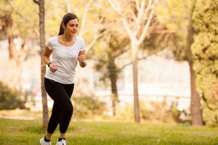 young beautiful woman jogging