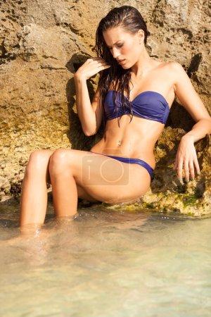 Portrait of sexy model enjoying a bath in the ocean
