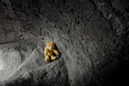 Teddy bear on the stairway