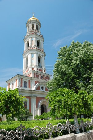 Photo for The church bell tower and garden trees - Royalty Free Image