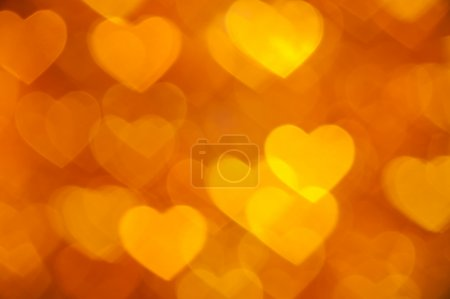 Golden bokeh of hearts background