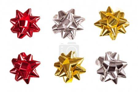 Set of bows made of shiny ribbon