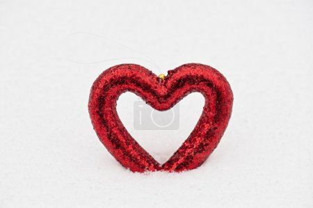 Heart on snow background