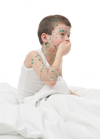 sick boy cough in white bed