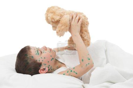 sick boy in white bed