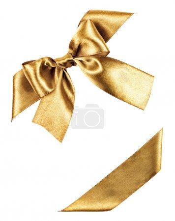 Photo pour Noeud doré en ruban de soie isolé - image libre de droit