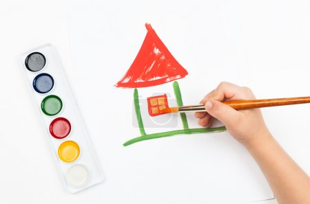 Photo for Child draws house with watercolors - Royalty Free Image