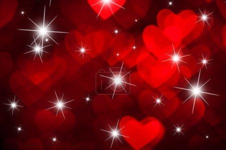 Photo pour Coeur rouge forme avec des étincelles comme arrière-plan - image libre de droit