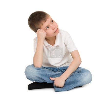 meditative boy on white