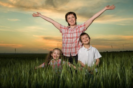 Photo for Happy family at sunset - Royalty Free Image