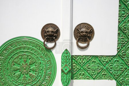Traditional Chinese Door knocker with green floral pattern