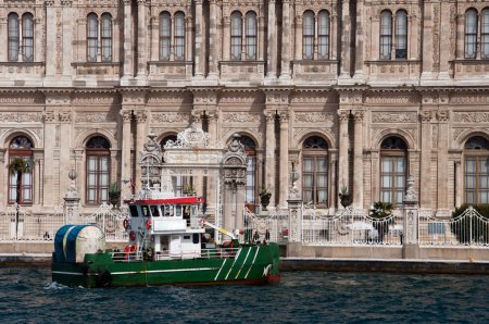 Small ship in front of the Dolmabahce palace in Istanbul, Turkey