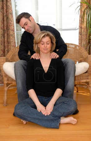Photo for Man giving a massasge on the shoulders to his wife - Royalty Free Image