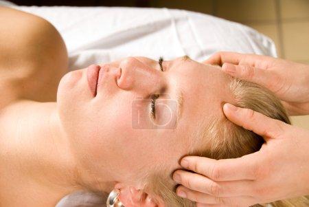 Photo pour Woman on a massage table at a spa - image libre de droit