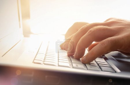 Photo for Photo of man's hands typing on laptop keyboard - Royalty Free Image