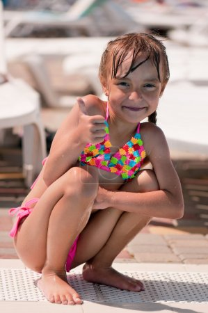 Photo for Happy little girl in swimsuit isolated on white background - Royalty Free Image