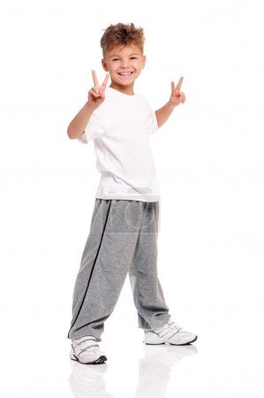 Photo for Happy boy showing victory signs isolated on white background - Royalty Free Image
