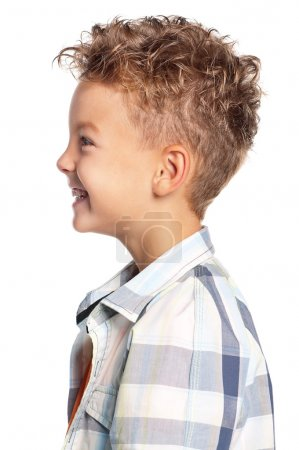 Photo for Profile portrait of young boy, isolated on white background - Royalty Free Image