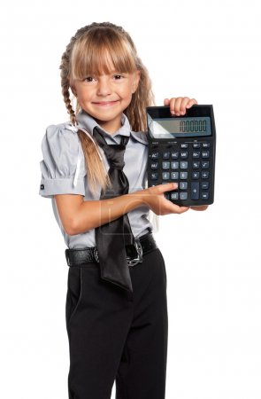 Photo for Little girl in school uniform with calculator isolated on white background - Royalty Free Image