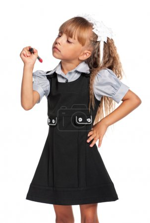 Photo for Happy little girl in school uniform with marker isolated on white background - Royalty Free Image