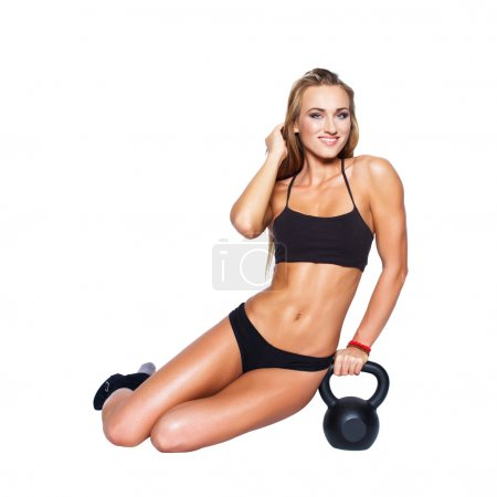 Sexy blonde fitness model with kettlebell