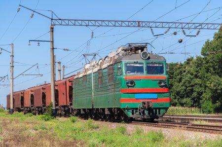 Electric locomotive hauling a grain train