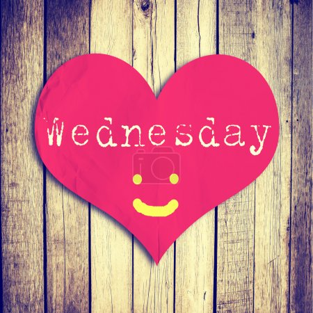 Love Wednesday on red heart shape with wooden wall