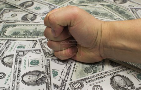 Money (federal reserve notes) and fist