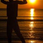 Man shadow enjoying the sunrise...