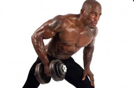 Black bodybuilder training with dumbbells. Strong man with perfect abs, shoulders,biceps, triceps and chest. Isolated on white background