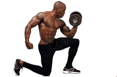 Black bodybuilder training with dumbbell. Strong man with perfect abs, shoulders,biceps, triceps and chest. Isolated on white background
