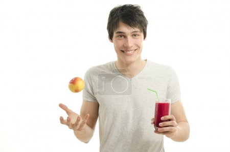 Man preparing a red smoothie from bio apples, eating healthy for an active life,dieting
