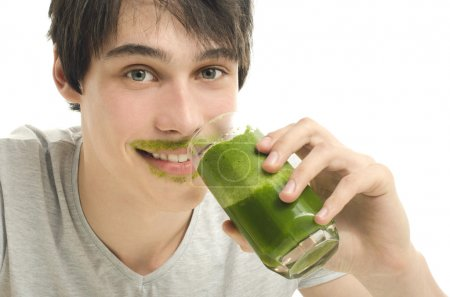 Man drinking an organic smoothie, eating healthy for an active life, dieting