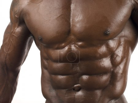 Close up on perfect abs. Strong bodybuilder with six pack and perfect chest