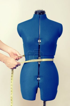 Tailor mannequin with measuring tape isolated, hands with centimeter