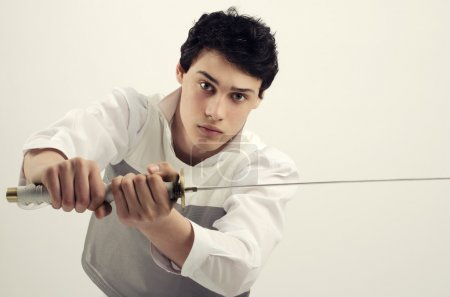 Man dressed in white holding a katana, Young beaut...