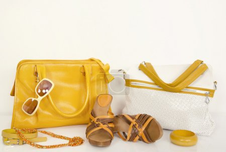 Cute summer yellow bags with matching sandals and accessories.