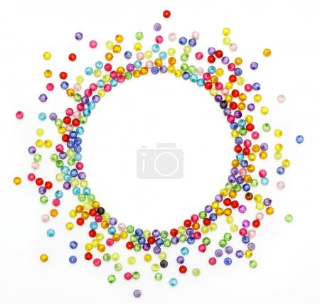 Colorful beads, circle shape space for photo or text isolated on