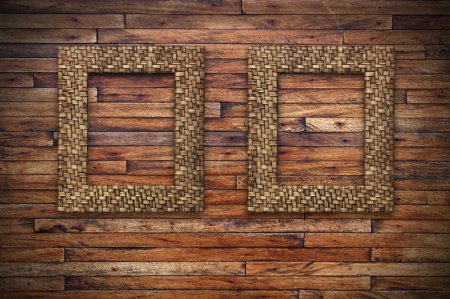 Two bamboo frames on wood wall