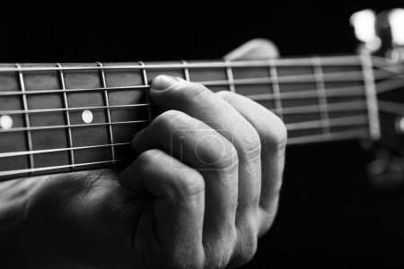 Photo for Guitar in hands in the guy playing it - Royalty Free Image