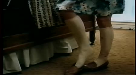 Close-up of womans legs while she changes clothes