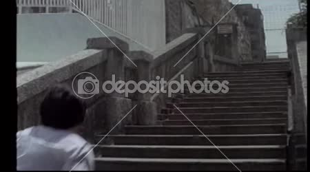 Rear view of man running up stairs