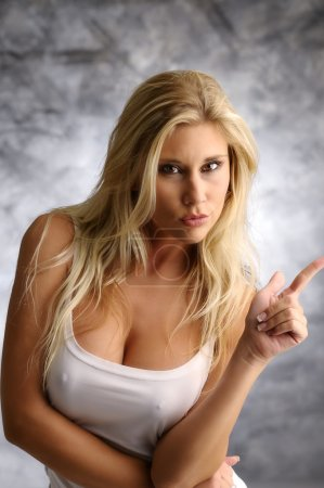 Strict blond girl in a white shirt...
