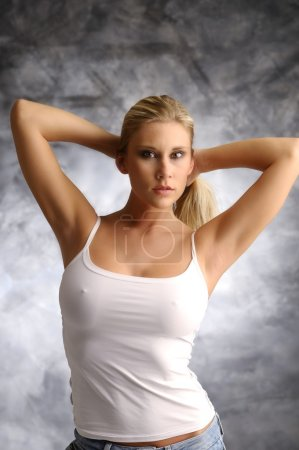 Blonde girl in white shirt on smoky background...