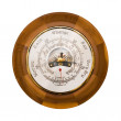Traditional wooden barometer and thermometer isola...