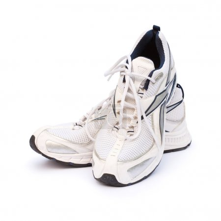 Mens running shoes against a white background