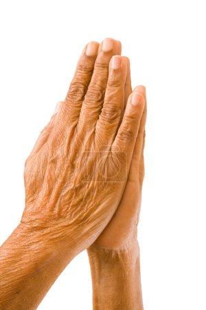 Old hands praying