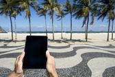 Traveling Tourist Using Tablet Copacabana Rio de Janeiro Brazil